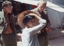 Troops and Viet woman