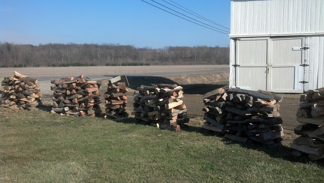 Wood-racks are full of Best of Both Farms' famous Cherry Wood.