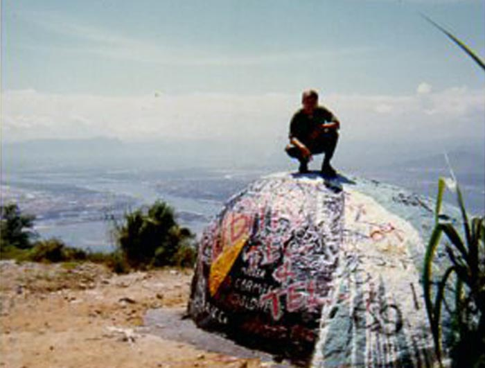 20. Da Nang AB: 366th TFW: Monkey Mountain's Boom-Boom Rock. Units that climbed to the top repainted the rock. 1969. [Peter Halferty photo].