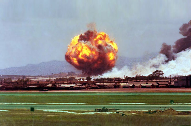 1. Da Nang AB: 366th TFW: From the flightline, the grassfire is out of control and bombs are cooking off west of the runway's 4K marker. April 27-1969. [Peter Halferty photo].