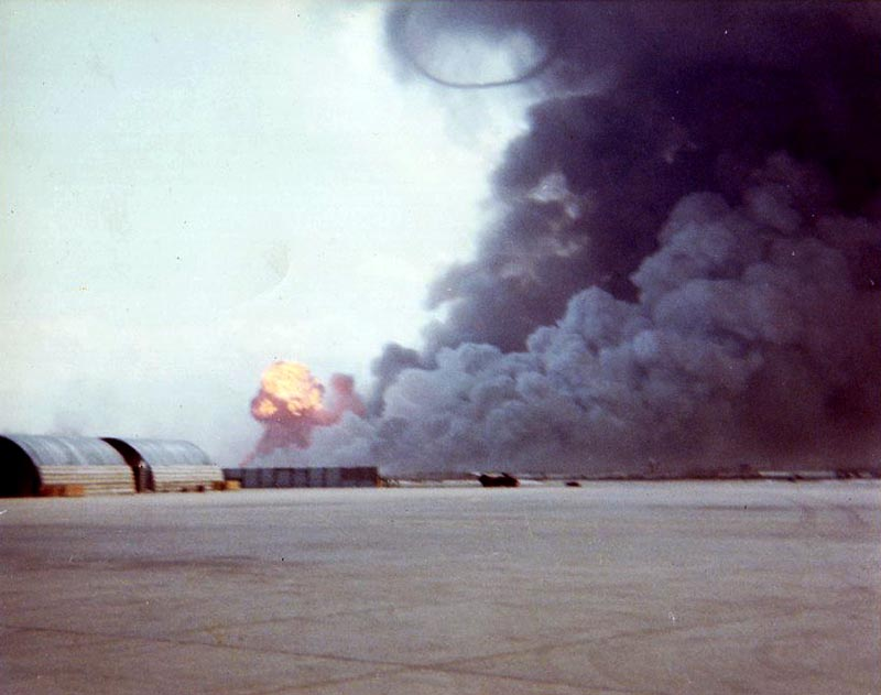 3. Da Nang AB: 366th TFW: Flightline view. Aircraft were quickly towed or taxied north and south or under revetments. Note the giant smoke-ring roiled perfectly to the heavens. April 27-1969. [Peter Halferty photo].