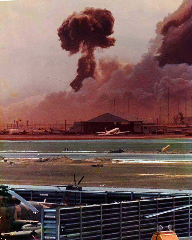 9. Da Nang AB: 366th TFW: From the bottow of the black column of smoke, you can see a rocket of something that cooked off blasting away like a roman-candle! April 27-1969. [Peter Halferty photo].