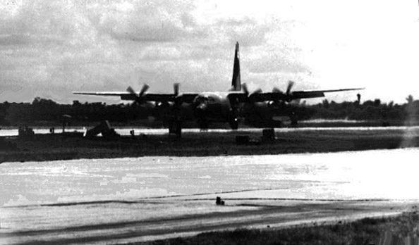 9. Da Nang AB, 366th TFW: C-130 on rolling-takeoff. 1969-1970. [Photo by Ed Burchard].