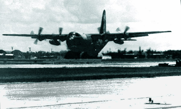 10. Da Nang AB, 366th TFW: C-130 runway lift-off, and landing gear coming up. 1969-1970. [Photo by Ed Burchard].