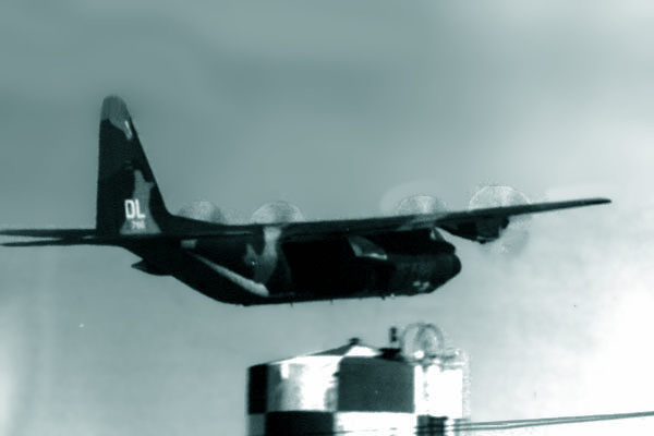 11. Da Nang AB, 366th TFW: C-130 airborne, landing gear tucked away. 1969-1970. [Photo by Ed Burchard].