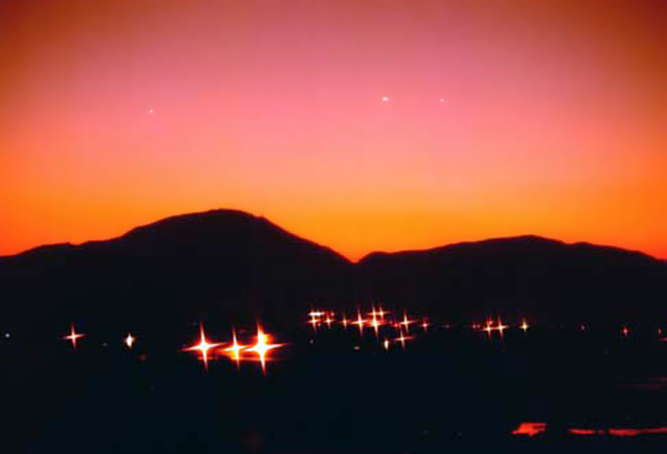 6. Da Nang AB, 366th TFW: Twilight's last gleaming...and if you look closely, can see the first stars appearing. 1969-1970. [Photo by Ed Burchard].