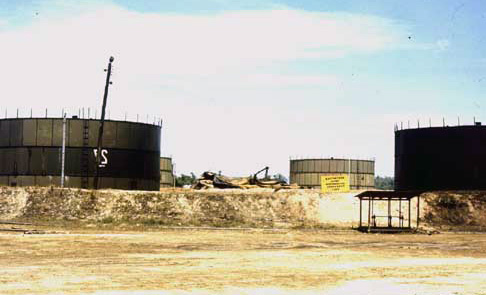 18. Da Nang AB, 366th TFW: Nearby POL Tank Farm survives with the are rocket cratered. 1969-1970. [Photo by Ed Burchard].