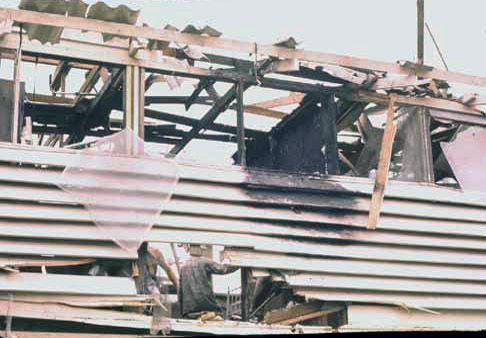 12. Da Nang AB, 366th TFW: Direct hit destroys barracks. 1969-1970. [Photo by Ed Burchard].