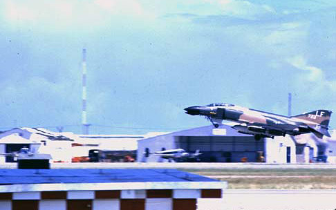 76. Da Nang AB, 366th TFW:Morning F-4 Phantom catapults off runway. 1969-1970. [Photo by Ed Burchard].