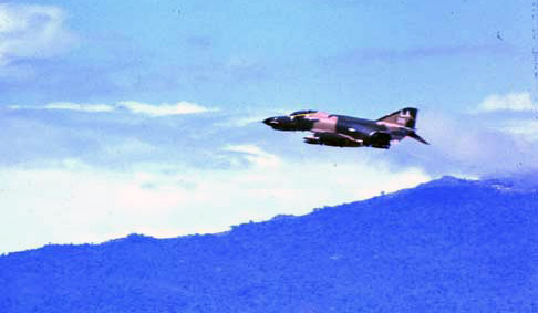 9. Da Nang AB, 366th TFW:Morning F-4 Phantom and non afterburners takeoff. 1969-1970. [Photo by Ed Burchard].