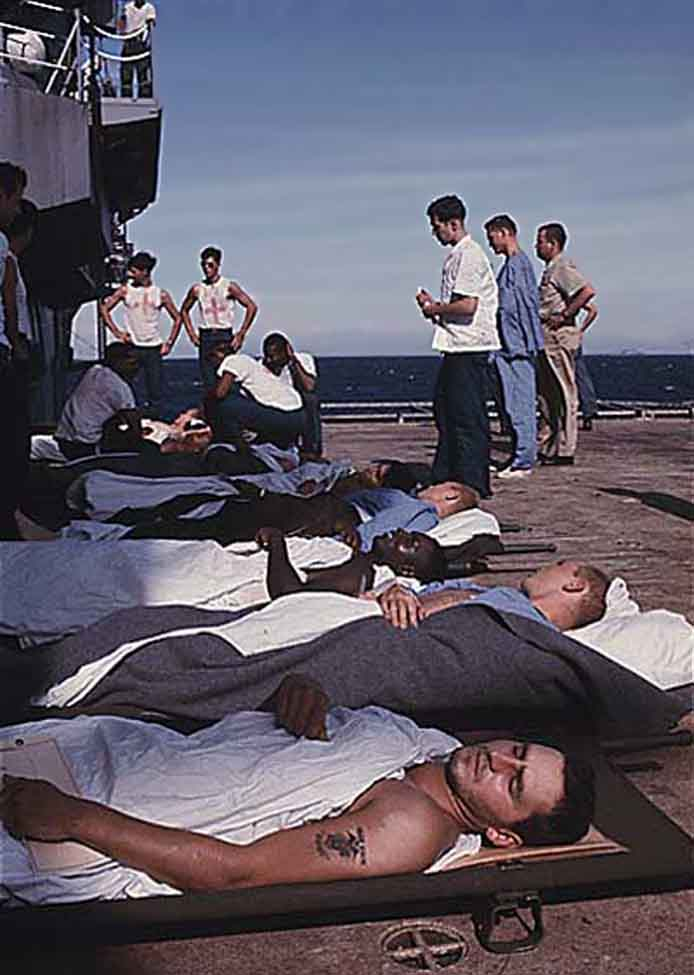 Da Nang Harbor. USS Repose, hospital ship docked. Wounded placed on deck awaiting bed space below.