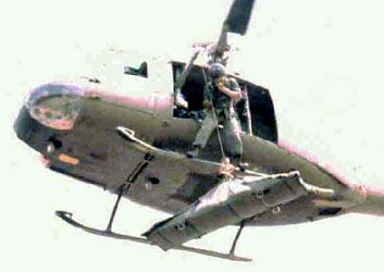 Wild Child II: Angel of Mercy, Huey Chopper. Hosting a Stretcher. 1968.