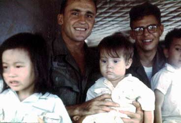 Wild Child II: Angel of Mercy, Huey Chopper. Crewman with Wounded Vietnamese Children. 1968.