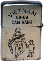 Zippo: (Front) Viet Nam, Cam Ranh 1968-1969 (Photo: soldier and child)