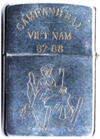 Zippo: (Back) CAM RANH BAY, VIET NAM, 67-68. [Photo: Nude Girl in bed] 1967-1968.