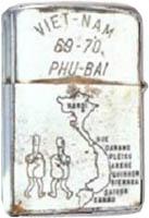 Zippo: (Back) VIET-NAM 69-70, PHU-BAI, (Cartoons) Two dickie-bird-Fingers and Map of N/S Vietnam, 1969-1970